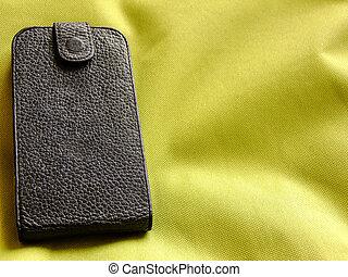 Smartphone in Flipcase on greenish Background - Black...