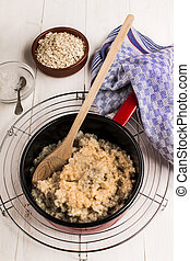 fresh warm porridge in an enamel pot - healthy and warm...