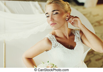 Bride stands with closed eyes bending over the piano