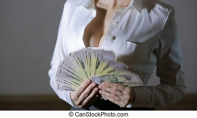 Beautiful young slim girl considers money - sexy young girl...