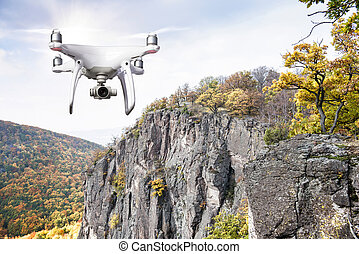Hovering drone taking pictures of autumn nature. Colorful...