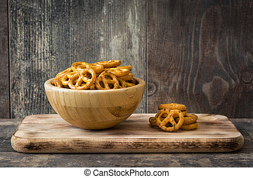 Pretzels in bowl on wooden table