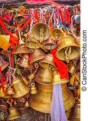 Pathivara Devi Temple - Photo of many golden bells with red...