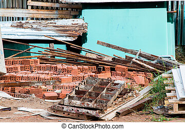 Close-up of a construction site excavation and wood scrap.