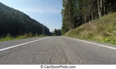 Speeding front camera on the car, road in Romanian...