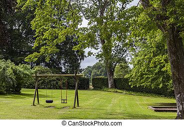 Swingset in park - Image of childrens swingset in green...