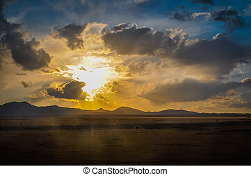 Sunset in Ala Archa - Photo of sunset on cloudy sky in Ala...