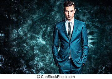 classic suit - Fashion shot of a handsome young man in...