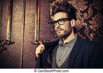 elegant glasses - Portrait of a well-dressed imposing man in...