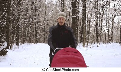 Man with baby carriage in forest HD