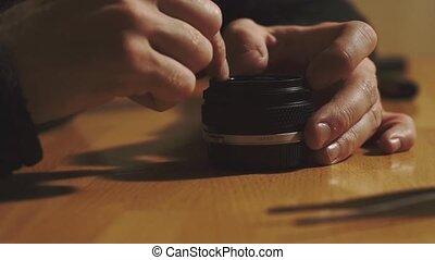 Man hands repair lens
