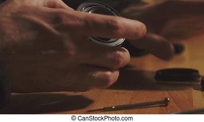 Man hands repair lens HD