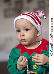 child in a Santa's helper elf