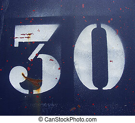 the number 30 thirty sprayed in white on a rusty blue metal...