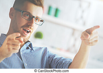 Attractive male pointing with fingers - Close up of...