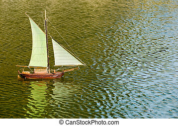 sailboat on the lake with reflection. Handmade remote...