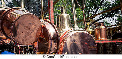 copper pots and pans - Assortment of copper kitchenware in...