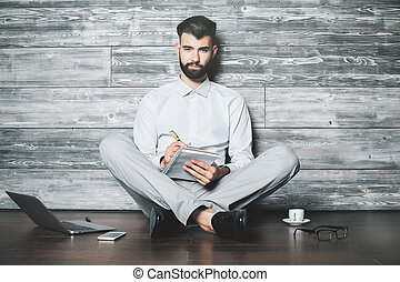Businessman with notepad