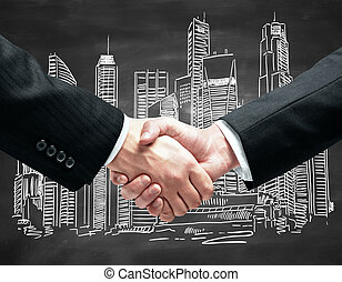 Handshake closeup - Close up of handshake infront of...