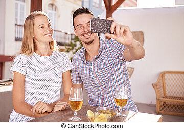 Beautiful couple posing for a selfie - Beautiful young...