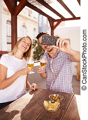 Couple taking selfie with their drinks - Happy couple with...