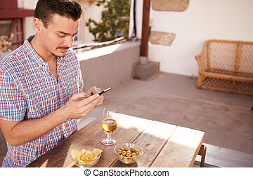 Handsome young man typing a message - Handsome young man...