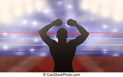 Boxer with arms raised on the ring