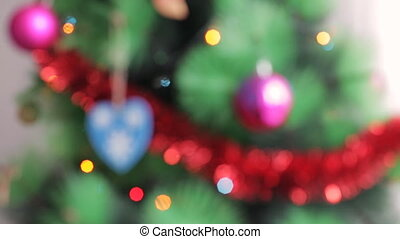 Christmas tree blurred background. Abstract defocused New...