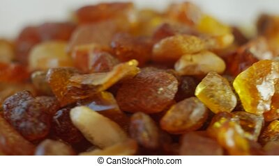Amber stones on turn table - Amber stones from Baltic see on...