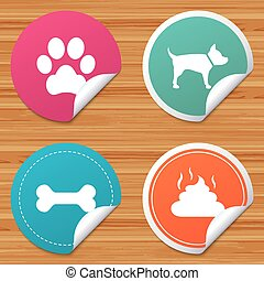 Pets icons. Dog paw and feces signs. - Round stickers or...