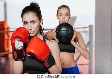 Sexy female boxers posing - Look at us. Two attractive...