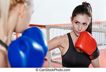 Intent strong woman boxing with her friend - Intense moment....