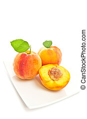 Peaches - Three peaches on a white background Vertical shot