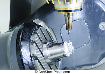 The five-axis Computer Numerical Control (CNC) machine while...