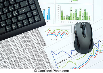 Business charts - Black keyboard and mouse on a stock chart.