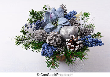 Christmas greenery with silver glitter decor and blue silk poinsettias