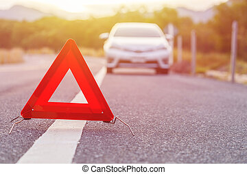 Emergency stop sign and broken silver car on the road - Red...