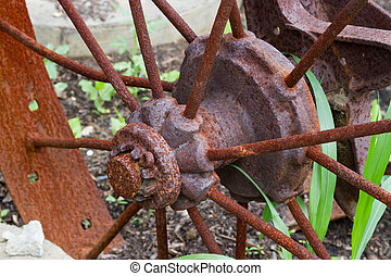 Rusty wheel spokes and hub - A old, rusted wheel hub and...