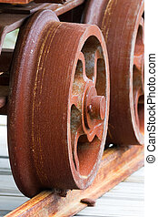 Rusty Mine Cart Wheel on Rail - A rusty mine cart wheel on a...