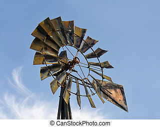 Antique Windmill Blue Sky and Clouds - A rustic, old metal...