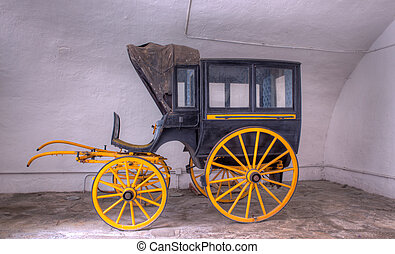 View of ancient carriage - View of ancient black and yellow...