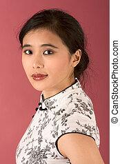 Chinese girl in white cheongsam