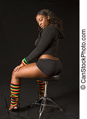 Glamorous African-American girl on stool