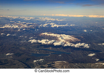 landscape from plane window of high mountain in italy after...