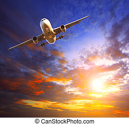 passenger jet plane preparing to landing against beautiful dusky sky use for traveling industry and cargo transport business topic