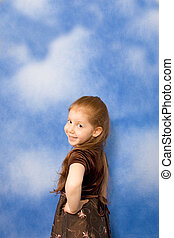 Portrait of redhead young girl with long hair