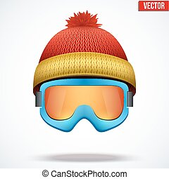 Knitted woolen red cap with snow goggles. Winter seasonal...