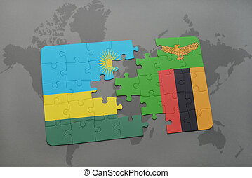 puzzle with the national flag of rwanda and zambia on a...