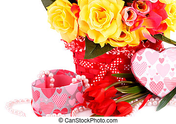 Valentine's day - Colorful flowers, beads and gift box close...