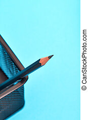 One pencil in a wire mesh pencil holder. - One pencil in a...